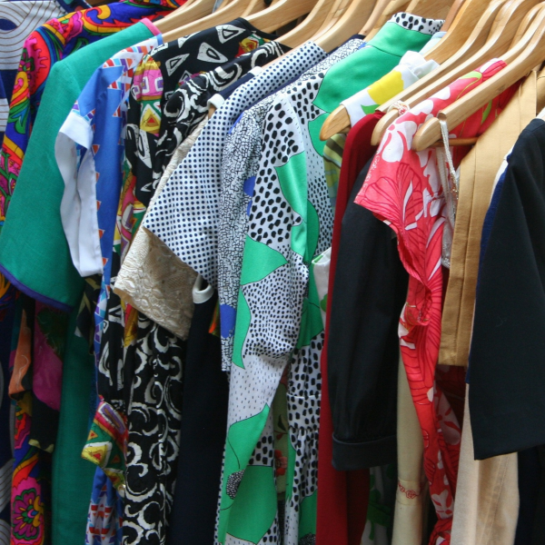 Second-hand clothes hanging on a rail