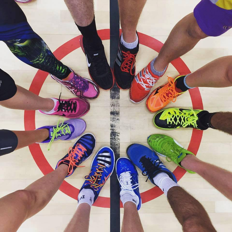 Photo of colourful shoes with rainbow laces in a circle